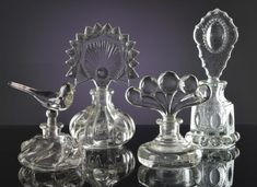 FOUR PRESSED GLASS PERFUME BOTTLES Lot 84