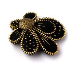 Unusual Zipper Brooch,Flower  of Felt, Zipper Jewelry, Black & Gold Handmade Brooch with Button. via Etsy.