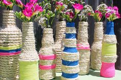 Make these vases out of old bottles and rope.