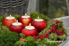 Real apples as candle holders, just the right pop of red :)