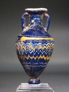Eastern Mediterranean core-formed blue glass amphoriskos.      6th-5th century BC.