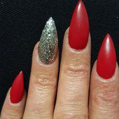 Red matte with silver glitter stilettos. My personally done Christmas nails. Simple yet fabulous.