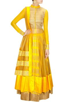 This anarkali lehenga set made in yellow raw silk lehenga heavily embroidered with gold dori work in floral pattern and tassels on side. This lehenga set is pai
