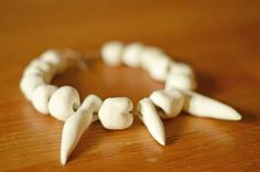 Fabulous jewellery has been found at stone age sites such as this one at Skara Brae, a Neolithic site in Orkney in Scotland. It is made from bone and tusks - they used many kinds of bones including tusks from wild boar which they would have hunted. Dinosaur Projects, Dinosaur Crafts, Stone Age Ks2, Night At The Museum, Craft Projects For Kids, Ice Age, Bronze Age, How To Make, Necklace Tutorial