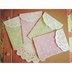 Mini favor envelopes made with paper dollies :)