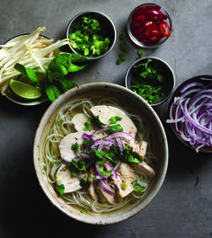 "Chicken Pho from ""The Pho Cookbook,"" by Andrea Nguyen. There are plenty of places to order pho, but Nguyen offers tasty recipes for those who want to make it at home. (John Lee/Courtesy Ten Speed Press)"