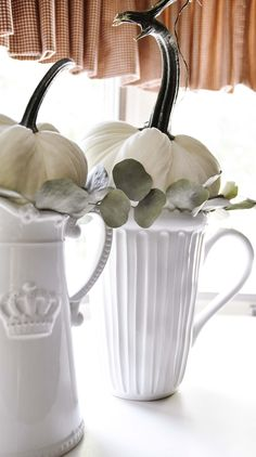 Fall kitchen decor...perfect pitchers to display pumpkins.