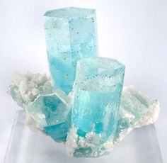 Blue zircon for Winter's birth stone on the mantle! These are natural zircon crystals