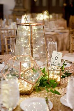 Romantic geometric centrepieces with lights #piecesandposies