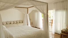 Luxe Turks and Caicos: Parrot Cays four poster beds in Garden View rooms face French doors that open to a veranda.