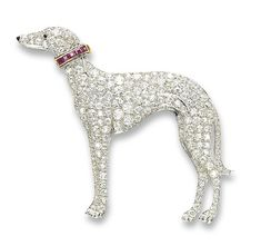 A STYLISH ART DECO DIAMOND, RUBY AND ONYX BROOCH CIRCA 1930 Designed as a greyhound, set throughout with old and circular-cut diamonds, with a detachable calibré-cut ruby collar, to the onyx eye and nose, with French assay marks for platinum and gold.