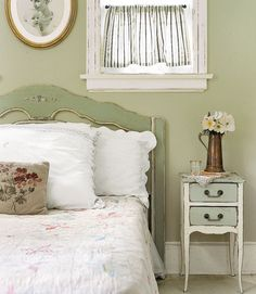 Inherited Interiors Let family heirlooms serve as visual fixtures, as seen here where a family member's portrait becomes a centerpiece for the rest of the guest bedroom's furnishings. Partnered with a refined, painted wood headboard, the gold frame evokes a sense of history and love.