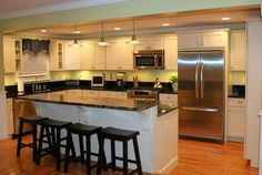 Ivory painted kitchen with step down island