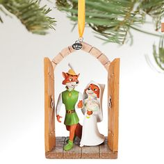 Fully sculptured figural ornament Satin ribbon for hanging Freestanding for desk or tree display 2016 Disney Store logo charm From Disney Store artist sketchbook designs inspired by Disney's Robin Hoo