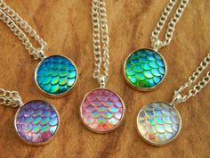 A gorgeous iridescent scales necklace, perfect for mermaid or dragon fans! Girly meets myth and magic these rings are eye catching and truly