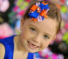 Gt ready for some football.  See me on Facebook too.    Florida Gators Hair bow  Your Choice Football Team by iguania03, $6.99
