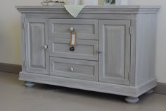 Custom changing table, refinished in Chalk Paint® French Linen; Paris Grey/Old White wash by Jamie Figari of Kalology Studio, Austin TX | 3801 South Congress Ave. Ste. 102 | 512.627.7376