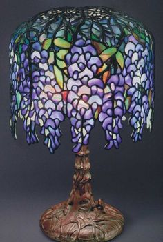 The Lamps of Louis Comfort Tiffany. Leaded glass, stained glass, floral, Wisterie flowers.