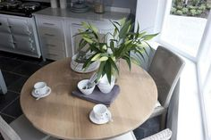 Grey chairs, oak table