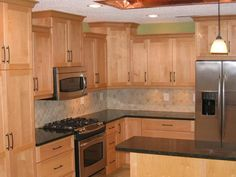 natural maple cabinets with quartz countertops 1