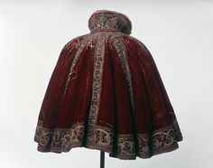 "vintagevision: "" Crimson silk velvet short round cloak, Museum of London House of Worth evening cape, Metropolitan Museum of Art "" See also: Dress for paper doll, 1895 Lithographer G. Renaissance Mode, Renaissance Clothing, Renaissance Fashion, 16th Century Clothing, 16th Century Fashion, 15th Century, Historical Costume, Historical Clothing, Historical Dress"