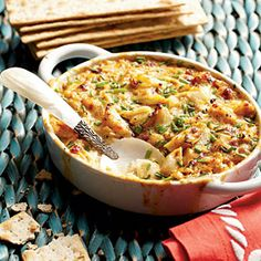 This Crab Dip is a continuous crowd-pleaser served best as golden brown and bubbly. Sprinkle with chives and serve with flatbread crackers to make a delectable Super Bowl party recipe or a casual weeknight appetizer.