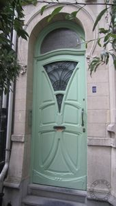 I'm in love with this door. Hobbit hole meets art deco? love it love it love it.
