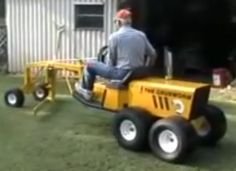 Homemade mini road grader adapted from a lawn tractor.