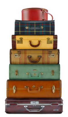 """Suitcases.  i started at a """"whim"""" collecting some colorful ones..for my office..i so hate file cabinets..then the internet and storage floppy's to disc's..to usb..but i do use them for holding older photo albums..and such."""