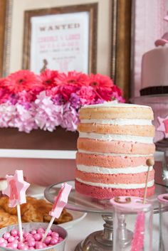 Still a naked cake but each layer is dyed a different shade of pink.  This would be great as part of a colour themed candy / sweet buffet