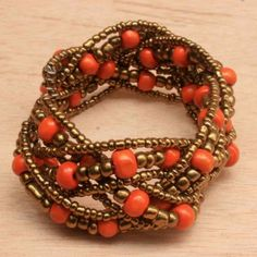 #Fairtrade #Handmade in Ecuador This beaded bracelet, with its orange beads, will spark your creativity and imagination. $35.00 http://www.artisansintheandes.com/beaded-bracelets-leather-ladies/beaded-bracelets-orange-wooden-braided-ladies