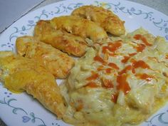 12-15 Skinless Boneless Chicken Strips, not cooked 1/4 – 1/2 cup buffalo sauce (I use Frank's) 1 – 24 oz bag shredded potatoes, thawed 1 cup of ranch dressing 1 1/2 cup shredded cheddar cheese 1 can cream of celery soup