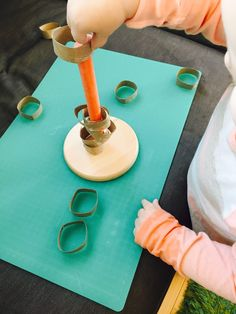 Put paper towel circles onto paper towel holder, 20 activities for 12-18 months old, 20 play ideas for toddlers, activities for one year old, montessori activities for a toddler, development promoting activities for toddlers, activities for 13 month old, activities for 14 month old, activities for 15 month old, activities for 16 month old, activities for 17 month old, activities for 18 month old, activities for a toddler, activities for one year olds, activities for two year olds