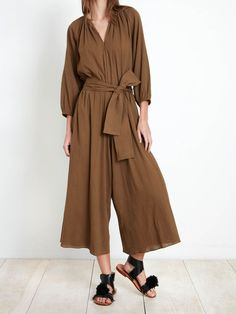 WIDE-LEG JUMPSUIT WITH WABI-SABI SHIRRING DETAIL AT NECK. TIES WITH DETACHABLE SELF BELT. POET SLEEVES ATTENUATE INTO BANDED CUFF. Color: Pachu Mama. Fabric- 100% Cotton Crepe.