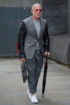 Nick Wooster wearing a suit jacket with leather sleeves and print trousers during London Fashion Week Men's