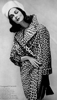 Carmen Dell'Orefice wearing a leopard coat by Ben Kahn, September 1957.  Photo by Richard Avedon.
