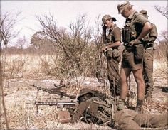 A member of the South African Defense Force's famous 32 Battalion trains regulars on the use of the Heckler and Koch general-purpose machine gun.