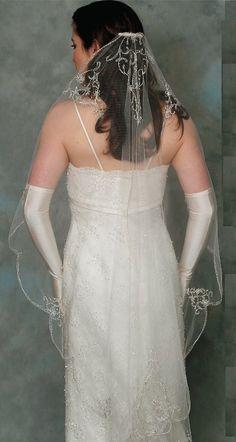 AN 862 Silver embroidered mantilla veil  $350