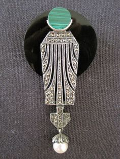 Art Deco onyx, malachite, pearl, and silver brooch, 1930s