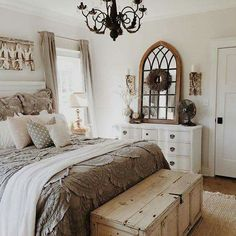 Neutral bedroom, whitewashed/stained trunk, arched mirror