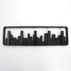 Dekorativer Haken, aus ABS hergestellt.          Skyline-Design mit…