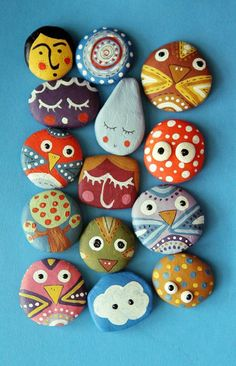 I need to go to Hobby Lobby and get some magnets to hot-glue on the back of things... like painted rocks.  Aren't these cute? They'd make really cute fridge magnets!