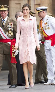 Pretty in pink! Queen Letizia of Spain highlighted her envious figure in a pale pink coat and dress at a military engagement in Salamanca, Spain.