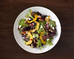 Acorn Squash Salad with Pomegranate Seeds and Goat Cheese