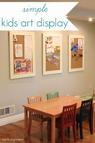 Simple kids art display with initials on the bulletin boards