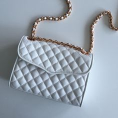 REBECCA MINKOFF New Quilted Mini In White Brand new, never been worn. Super cute for summer! Rebecca Minkoff Bags