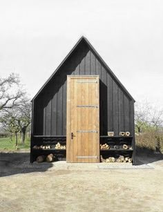 = black and wood cabin with exterior shelving