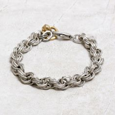"Our Chain Mail Bracelet from Rook & Crow is a perfect lightweight layering piece. This looks great layered with silver and gold bracelets and bangles. Add it to your jewel box today! 7 3/4"" long Antiq"