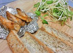 Teriyaki Chicken with bake bread and sunflower seeds.  03:12:15 .ไก่อบซอสเทอริยากิ