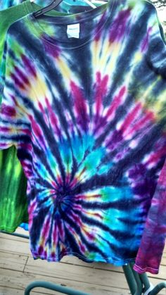 Black back Tie dye with tulip dye and black RIT dye. Fold for a spiral pattern...put colored dye on one side normally, on other side just cover with enough black dyes to cover white. Do not over saturate with black!